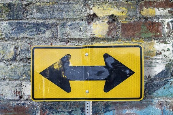 Picture of a Sign Pointing Both Directions